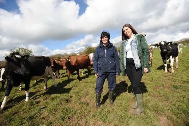 Dairy farmer Abi Reader, left, of South Wales, enjoyed meeting vegan campaigner Sarah King