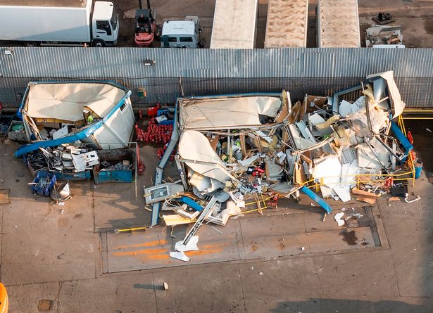 The remains of portable office buildings are seen at Paynes Metal Recycling plant near Iver in Buckinghamshire