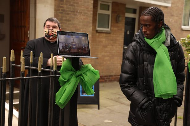 A live stream of the funeral service was shown to mourners outside the church