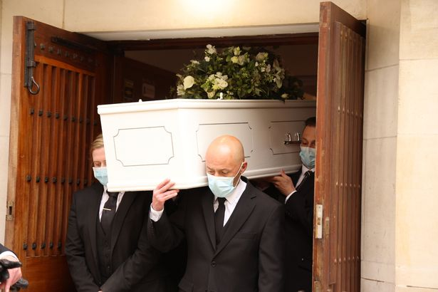 Richard's coffin is carried into St Thomas Kensal Town Church