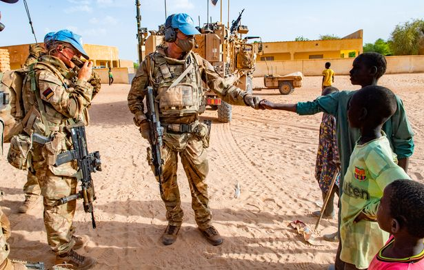 A soldier and a local greet each other with respect