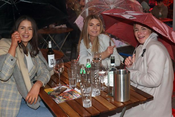 Three friends brave the cold at a pub in Leeds