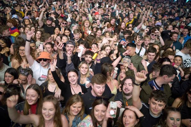 Concert-goers enjoy a non-socially distanced outdoor live music event at Sefton Park