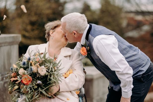 Man and woman kissing on wedding day