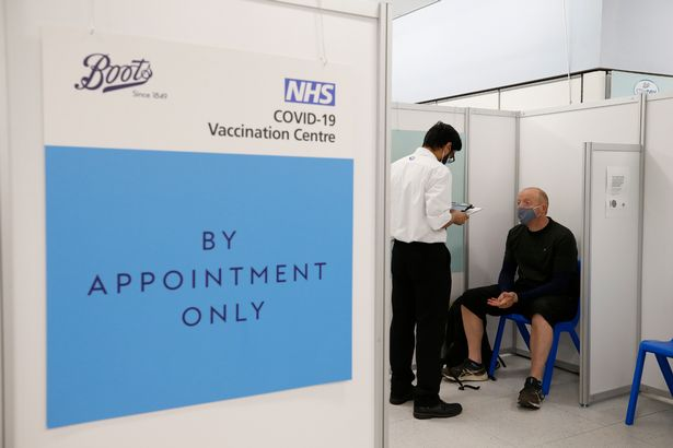Martin Gillibrand, 45, waits to receive a vaccination at a Boots pharmacy on Fleet Street in the City of London