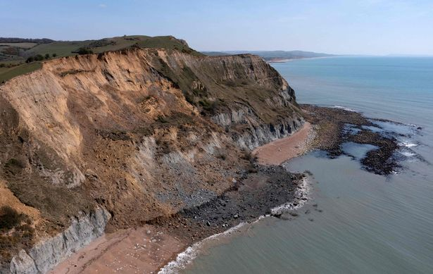 An overhead view shows the scene of a coastal cliff fall on Dorset's Jurassic Coast near the village of Seatown, on the south west coast of England on April 26