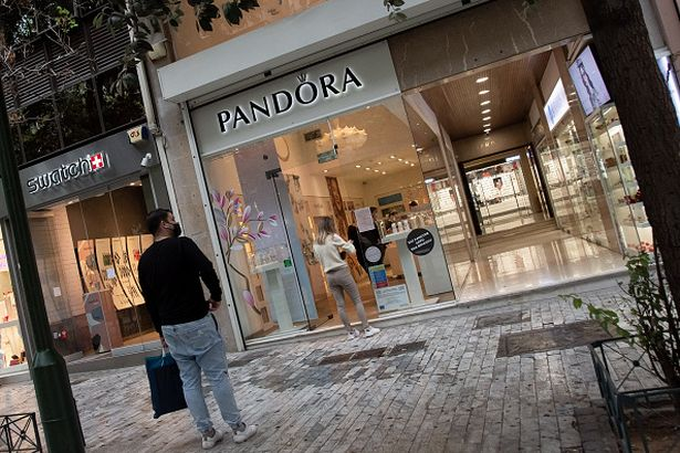 ATHENS, GREECE - 2021/04/24: People stand outside a Pandora store on Ermou street close to Syntagma square. (Photo by Nikolas Joao Kokovlis/SOPA Images/LightRocket via Getty Images)