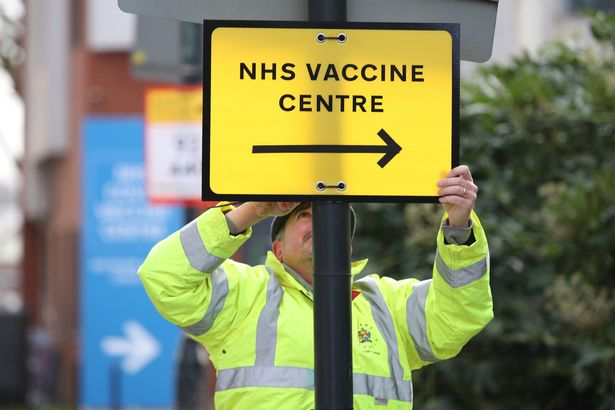A sign for an NHS vaccine centre
