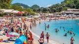 people on the Beach and boat in Paleokastrttsa, Corfu. Greece