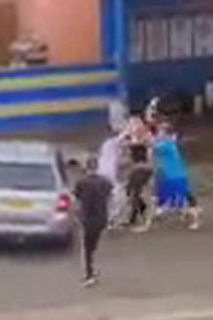 The fight took place outside a car wash and the cause of the dispute is not known