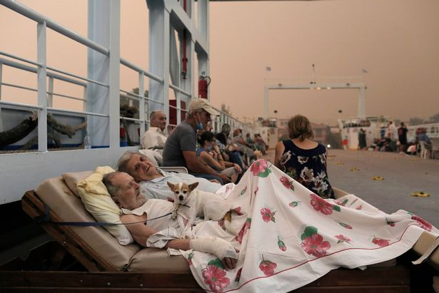 People sat on a ferry floor