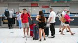 Holidaymakers catching flights to Palma and Tenerife at the Jet2 check-in desk at Glasgow Airport in Paisley