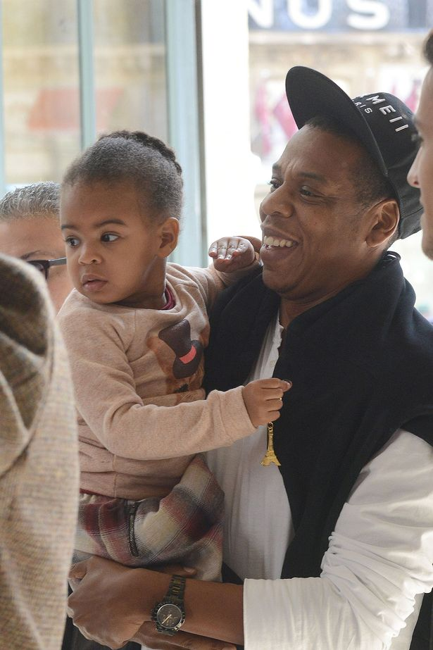Blue Ivy Clutches Tiny Eiffel Tower As She Leaves Paris