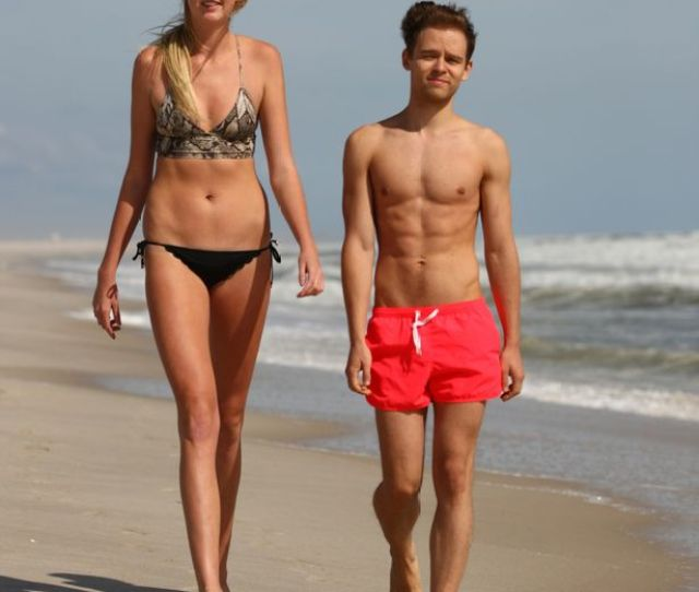 Holly Burt Posing With Tim Kurbanov On The Beach On September 25 2015 In New