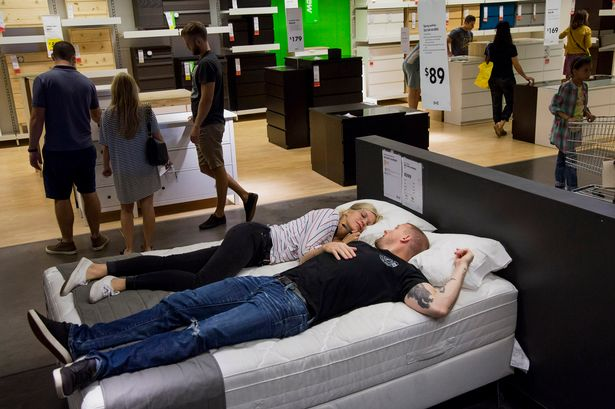 couple shopping for mattress