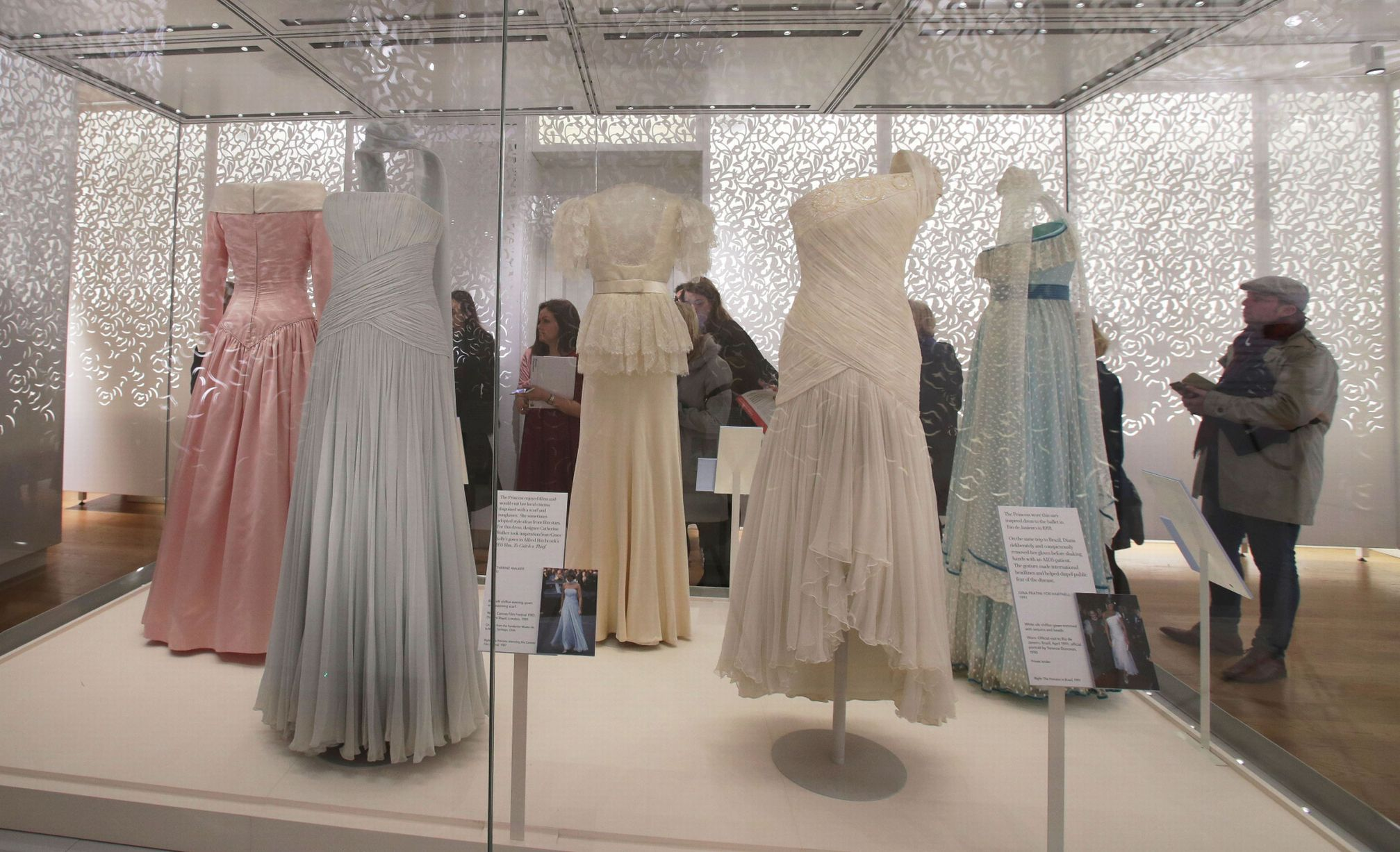 Inside Princess Diana s Fashion Story exhibition at Kensington     A blue silk chiffon evening gown worn by Diana to the Cannes Film Festival  in 1987  front left  and a white silk chiffon gown trimmed with sequins  worn on