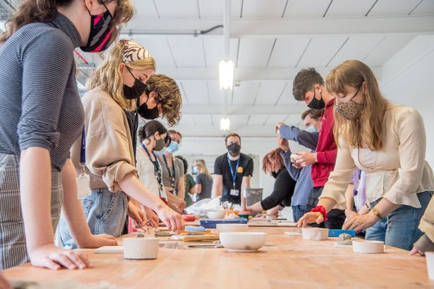 Stoke-on-Trent Sixth Form College students are seen making their medallions