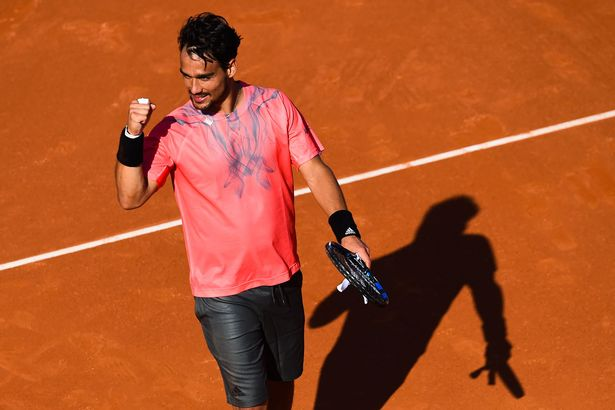 Fabio Fognini celebrates after defeating Rafael Nadal at the Barcelona Open
