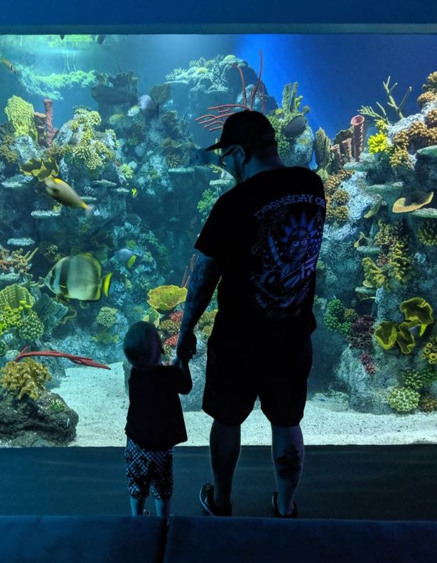 Max with his father Gavin in an aquarium