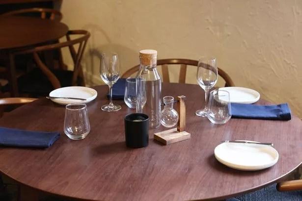 A dark wood set table at The Jackdaw