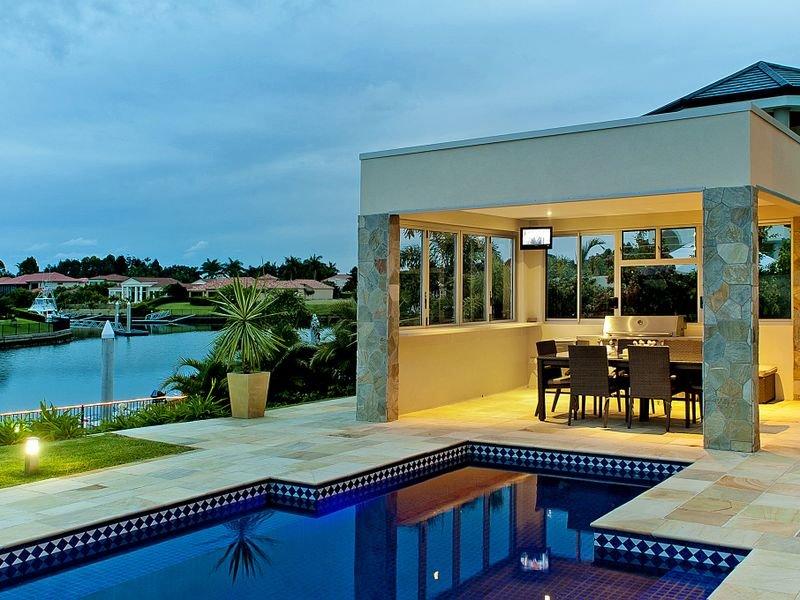 Indoor-outdoor outdoor living design with balcony ... on Fancy Outdoor Living id=98434