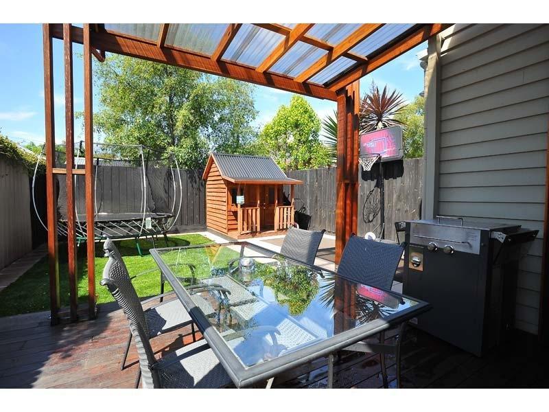 Indoor-outdoor outdoor living design with balcony ... on Fancy Outdoor Living id=82342