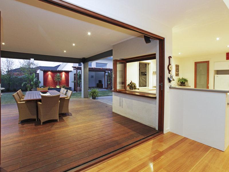 Indoor-outdoor outdoor living design with balcony ... on Fancy Outdoor Living id=73496