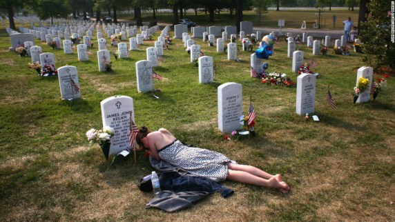 Image result for wife kneeling over husbands coffin