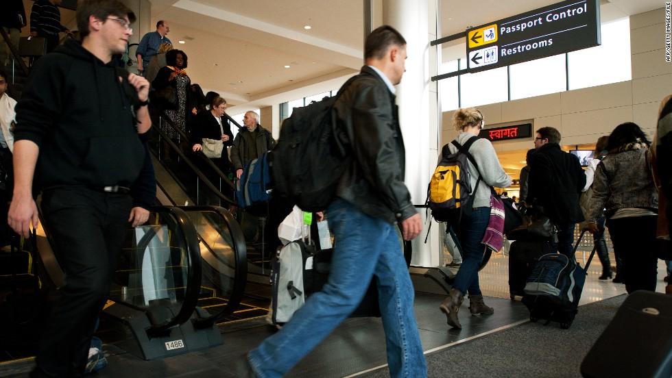 Arriving international air travelers head to Passport Control at Dulles International Airport.