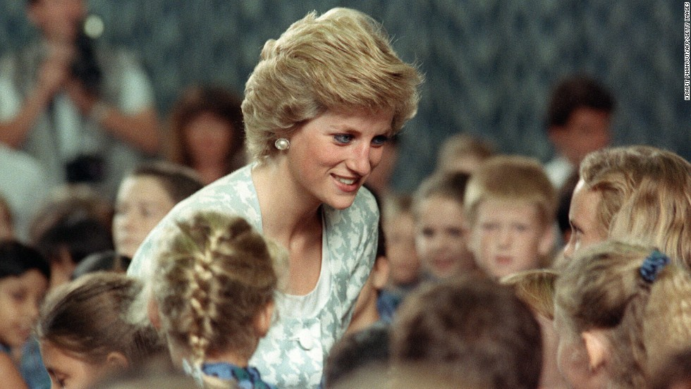 Diana, Princess of Wales listens to children during a visit to the British international school in Jakarta, Indonesia, on November 6, 1989.