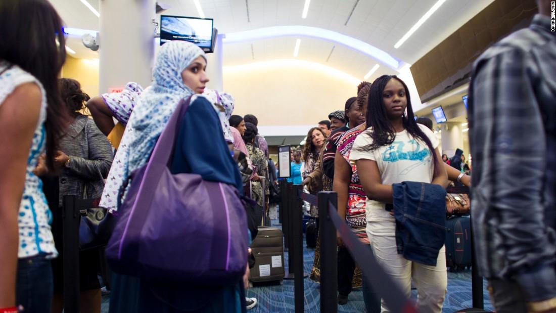 Passengers wait at a customs checkpoint at Atlanta's Hartsfield-Jackson International Airport.