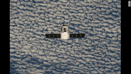 ISS039-E-013373 (20 April 2014) --- This is one of an extensive series of still photos documenting the arrival and ultimate capture and berthing of the SpaceX Dragon at the International Space Station, as photographed by the Expedition 39 crew members onboard the orbital outpost. The spacecraft was captured by the space station and successfully berthed, following the April 20 arrival.   The SpaceX Dragon arrives at the International Space Station on April 20, 2014. In 2012, the Dragon became the first private spacecraft to dock with the space station. It carries up cargo and brings back trash. SpaceX hopes to take crew members to the space station in the future.