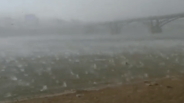 See beachgoers flee freak hail storm - CNN Video