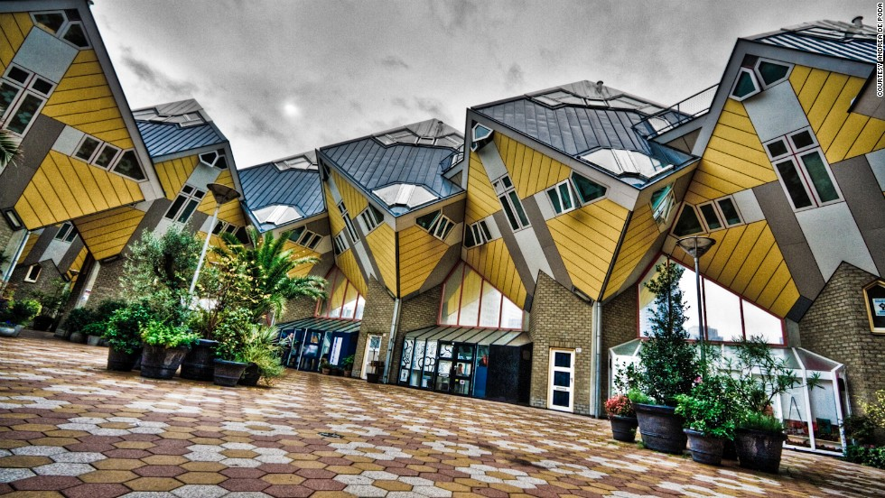 """The late Dutch architect Piet Blom designed these whimsical <a href=""""http://www.kubuswoning.nl/introkubus2.html"""" target=""""_blank"""">cubic houses</a> in Rotterdam and Helmond, in the Netherlands. The top part of the homes are tilted 45 degrees to create a dizzying effect."""