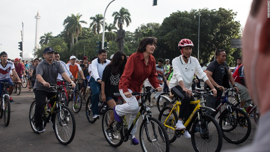 Image result for Cycling President Jokowi with Amanpour