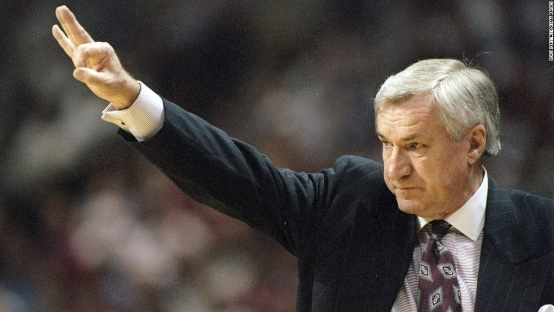 Coach Dean Smith of the North Carolina Tarheels gives instructions to his players during a playoff game in March 1997.
