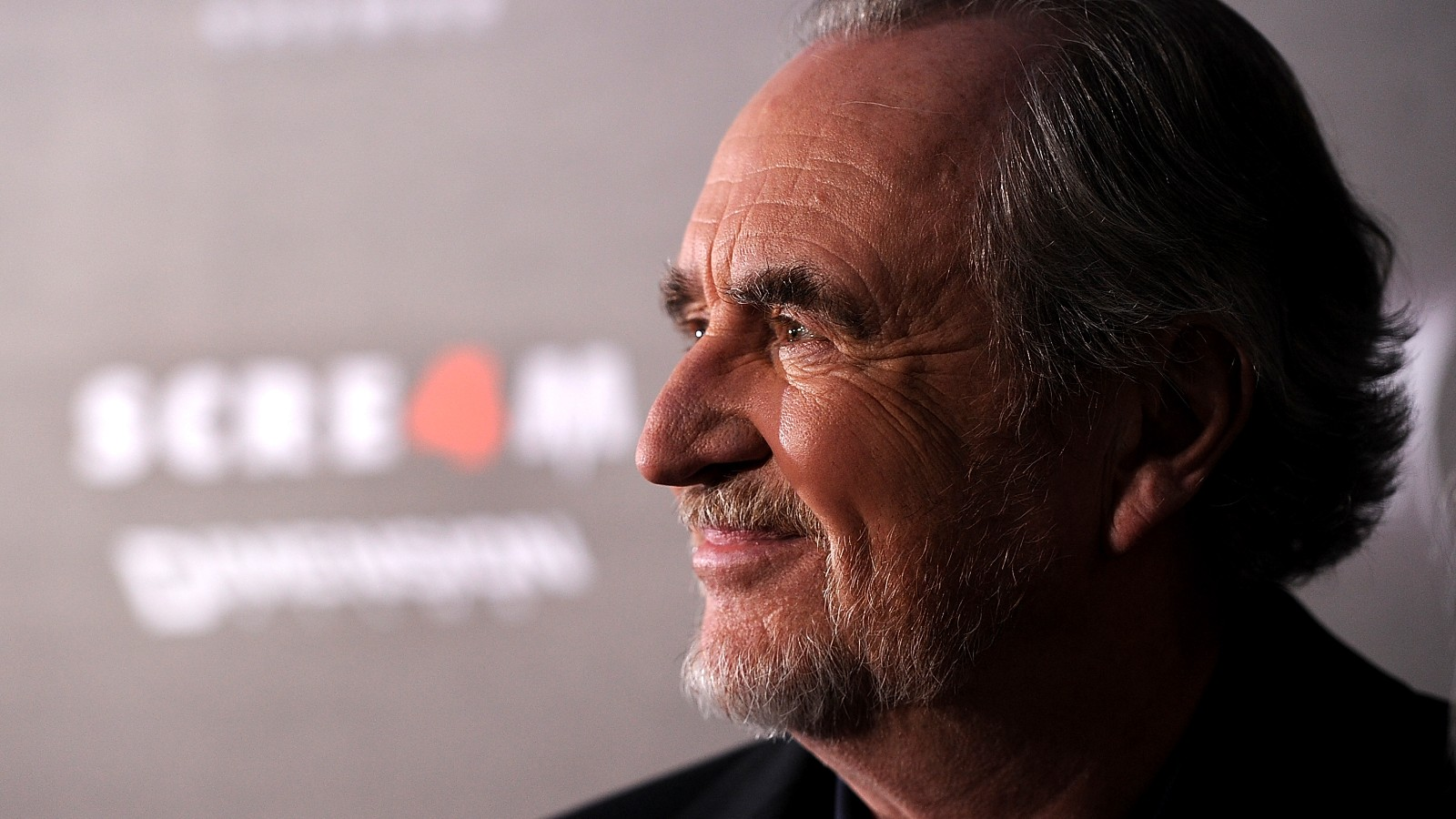 """HOLLYWOOD, CA - APRIL 11:  Director Wes Craven arrives at the premiere of the Weinstein Company's """"Scream 4"""" Presented by AXE Shower at Grauman's Chinese Theatre on April 11, 2011 in Hollywood, California."""
