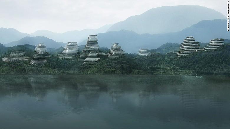 Come un antico dipinto cinese, MAD Architects & # 39;  Huangshan Mountain Village si erge sopra Taiping Lake.  Tranne il villaggio case assomigliano più capsule spaziali, e le montagne sono in metallo.