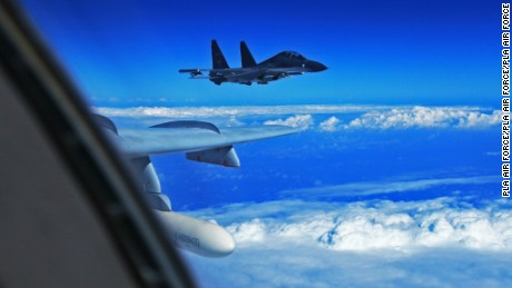 Image result for Chinese fighter flies inverted over US Air Force jet