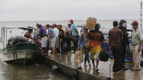 Residents board boats to leave before Hurricane Otto arrives in Bluefields, Nicaragua, on November 23, 2016.