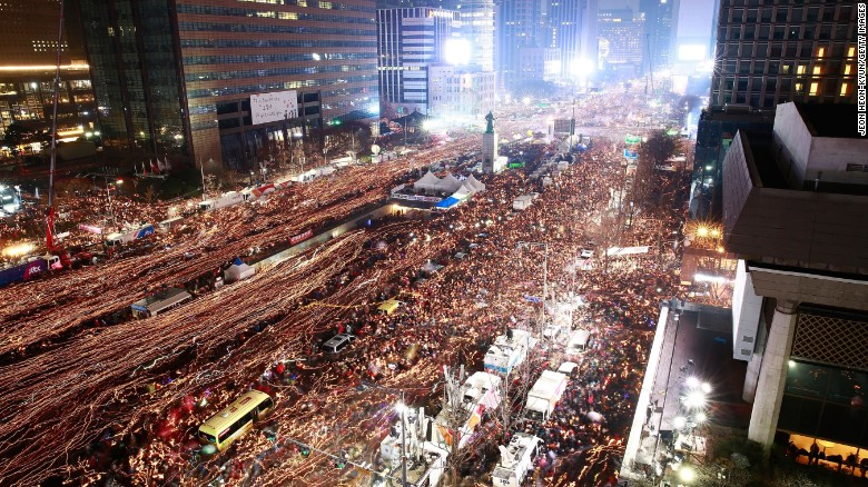 "Thousands of South Koreans take to the streets of Seoul to demand President Park Geun-Hye step down on November 26, 2016 in South Korea. (Read the full story <a href=""http://edition.cnn.com/2016/11/26/asia/south-korea-mass-protests/index.html"" target=""_blank"">here</a>)"