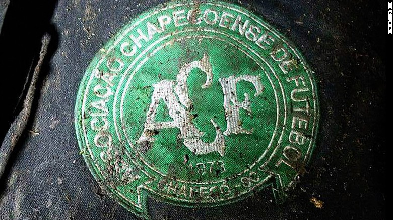 A logo of Brazilian football team Chapecoense is found at the site of the plane crash.