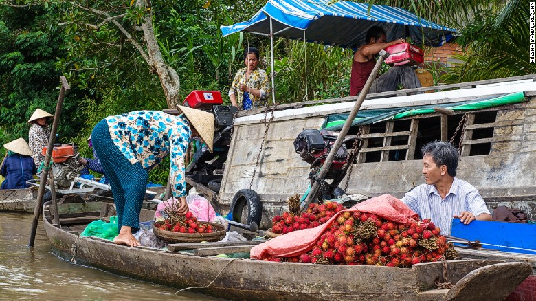 A proper Vietnam roadtrip isn't complete without a visit to a local floating market.