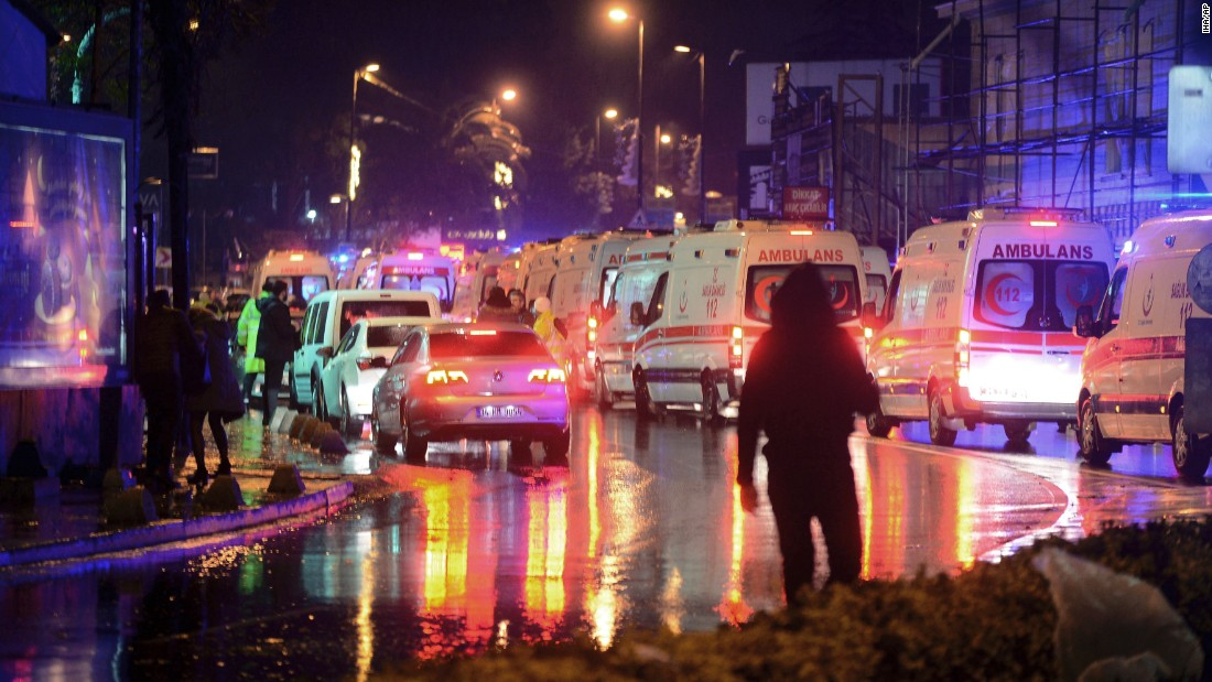 Medics and security officials work at the scene of the attack.