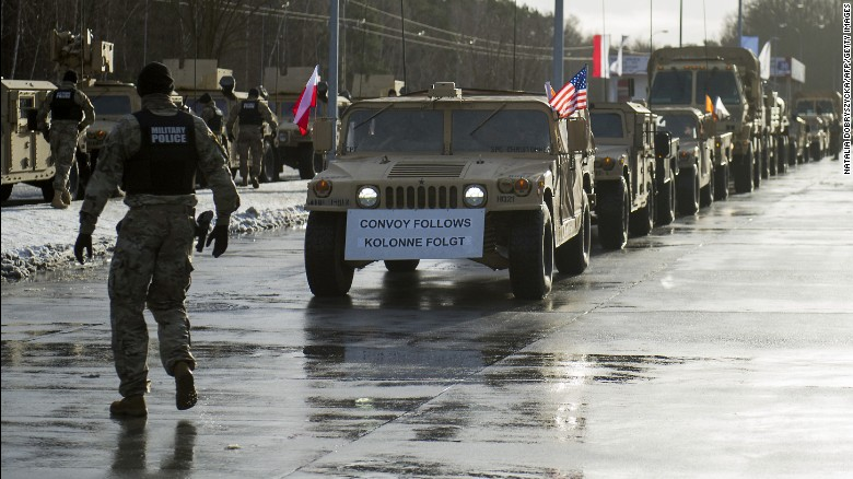 American soldiers receive a welcome this week at the Polish-German border in Olszyna, Poland.