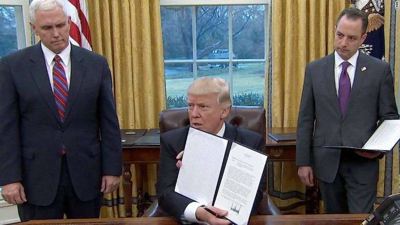 President Trump after signing executive actions in the first day of his presidency. CNN