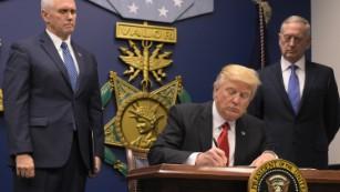 Trump signs executive order.