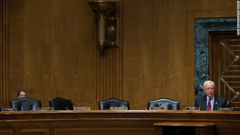 With empty Democrat seats to his right, committee chairman Orrin Hatch (R-UT) speaks during a meeting of the Senate Finance Committee to vote on the cabinet nominees on Capitol Hill, February 1, 2017 in Washington.(Photo by Drew Angerer/Getty Images)
