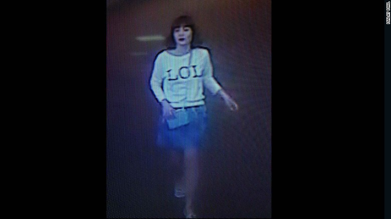 """This photo of closed circuit television footage shows a woman wearing a shirt with """"LOL"""" on it in Sepang, Malaysia, on Monday, February 13. The woman is one of the female suspects who has been detained in connection with the death of North Korean leader Kim Jong Un's half-brother, Kim Jong Nam, Selangor State Police Chief Abdul Samah Mat with the Royal Malaysian Police told CNN"""