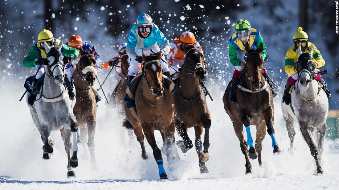 Horses race in the snow in St. Moritz, Switzerland, on Sunday, February 19.